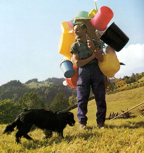 Person with Buckets and Jerrycans